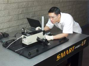 technician performing a calibration procedure on an Oriel monchromator